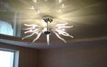 Как повесить люстру на натяжной потолок?
