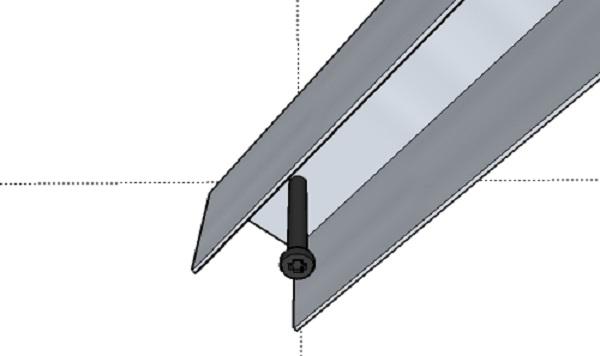 В месте отметки, обозначающей центр, вбуриваемся и вставляем дюбель. Дальше нам понадобится импровизированный циркуль. Для этого нужен кусок профиля UD, который нам и заменит его. Отрезаем профиль нужного размера и сверлим отверстия, расстояние между ними и будет нашим радиусом.